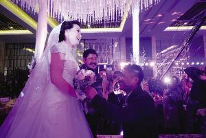 图为:吕小军婚礼现场。 来源:城市快报 摄影/崔跃勇 王建一